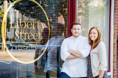 Chef Michael Kelly with wife and owner, Alex Kelly, in front of Liberty Street Bistro