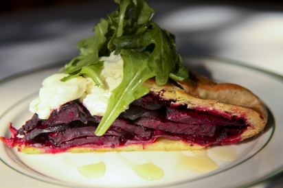 Beet pie with herb-infused crust, honey, goat cheese and arugula in an apple cider vinaigrette The Beverly Kingston
