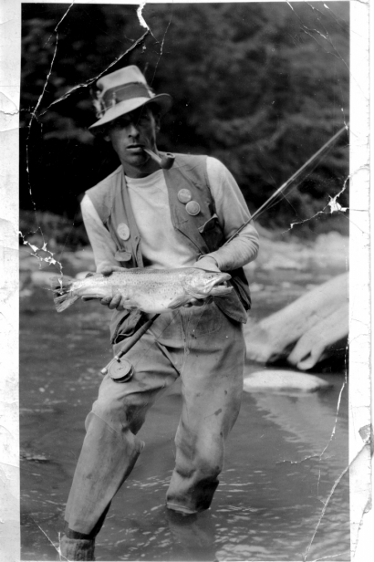 Fabled Esopus fishing guide and fly tying innovator Ray Smith, pictured on the Esopus with a large brown.