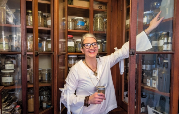 Owner of Field Apothecary, Dana Eudy, organizes her stock.
